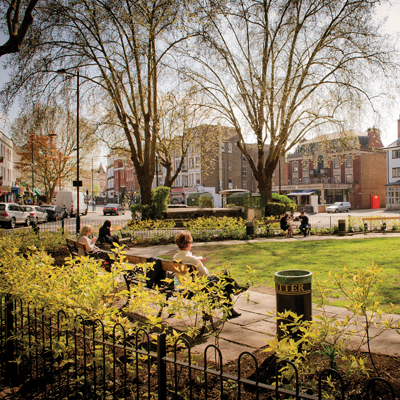 People sitting in a park in west Hampstead in North West London